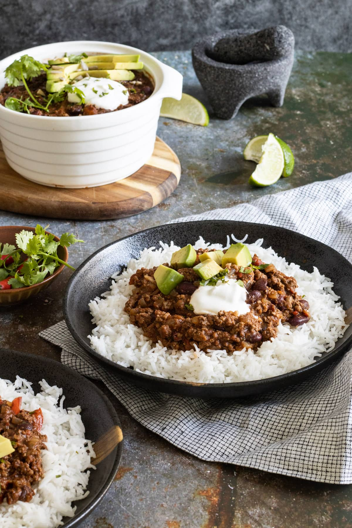 Slow cooker chilli con carne on a plate served with rice